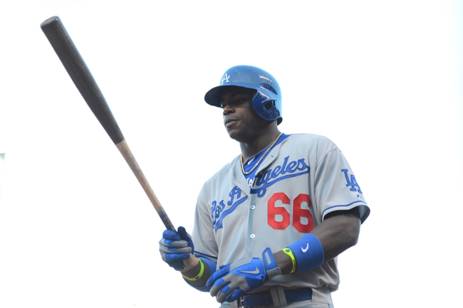 July 6, 2013; San Francisco, CA, USA; Los Angeles Dodgers right fielder Yasiel Puig (66) stands on deck during the ninth inning against the San Francisco Giants at AT&T Park. The Giants defeated the Dodgers 4-2. Mandatory Credit: Kyle Terada-USA TODAY Sports