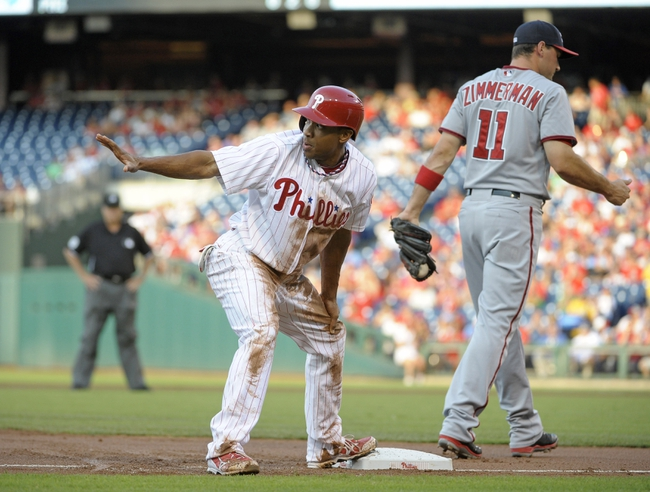 Jul 8, 2013; Philadelphia, PA, USA; Philadelphia Phillies center fielder Ben Revere (2) calls for time after stealing third base against Washington Nationals third baseman Ryan Zimmerman (11) in the first inning at Citizens Bank Park. Mandatory Credit: Eric Hartline-USA TODAY Sports