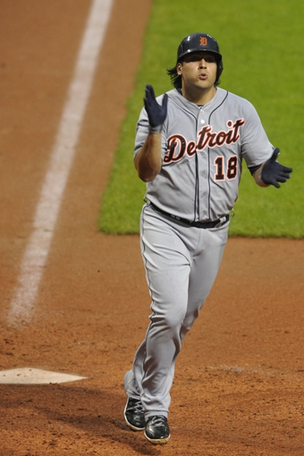 Jul 8, 2013; Cleveland, OH, USA; Detroit Tigers left fielder Matt Tuiasosopo (18) celebrates his solo home run in the fourth inning against the Cleveland Indians at Progressive Field. Mandatory Credit: David Richard-USA TODAY Sports