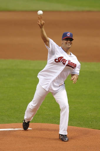 Jul 8, 2013; Cleveland, OH, USA; Cleveland Indians former shortstop Omar Vizquel throws out the first pitch before a game against the Detroit Tigers at Progressive Field. Mandatory Credit: David Richard-USA TODAY Sports