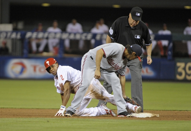 Jul 8, 2013; Philadelphia, PA, USA; Philadelphia Phillies center fielder Ben Revere (2) slides safely into second base ahead of tag by Washington Nationals second baseman Anthony Rendon (6) as umpire D.J. Rayburn (38) looks on in the sixth inning at Citizens Bank Park. Mandatory Credit: Eric Hartline-USA TODAY Sports