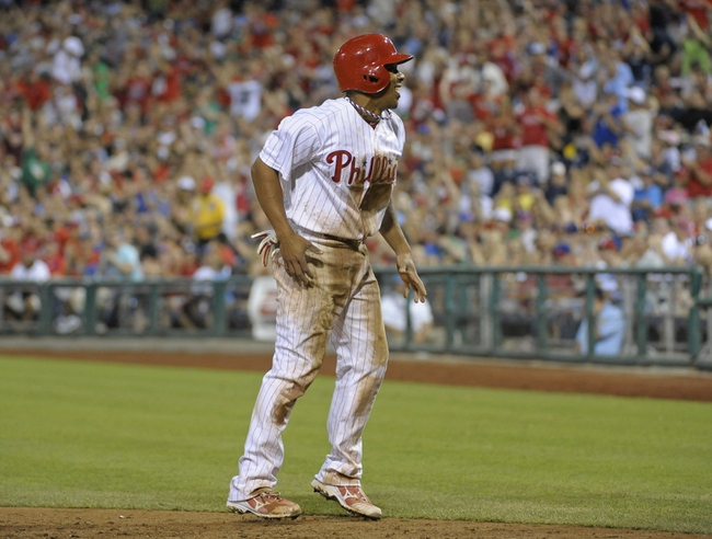 Jul 8, 2013; Philadelphia, PA, USA; Philadelphia Phillies center fielder Ben Revere (2) stands up after sliding safely into home against the Washington Nationals in the sixth inning at Citizens Bank Park. Mandatory Credit: Eric Hartline-USA TODAY Sports