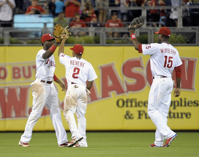 Jul 8, 2013; Philadelphia, PA, USA; Philadelphia Phillies left fielder Domonic Brown (9), center fielder Ben Revere (2) and right fielder John Mayberry Jr. (15) celebrate the final out against the Washington Nationals at Citizens Bank Park. The Phillies defeated the Nationals, 3-2. Mandatory Credit: Eric Hartline-USA TODAY Sports