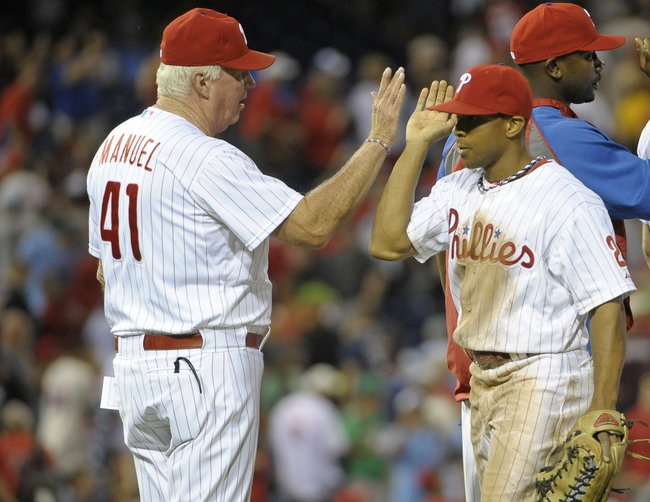 Jul 8, 2013; Philadelphia, PA, USA; Philadelphia Phillies manager Charlie Manuel (41) high fives center fielder Ben Revere (2) after the win against the Washington Nationals at Citizens Bank Park. The Phillies defeated the Nationals, 3-2. Mandatory Credit: Eric Hartline-USA TODAY Sports