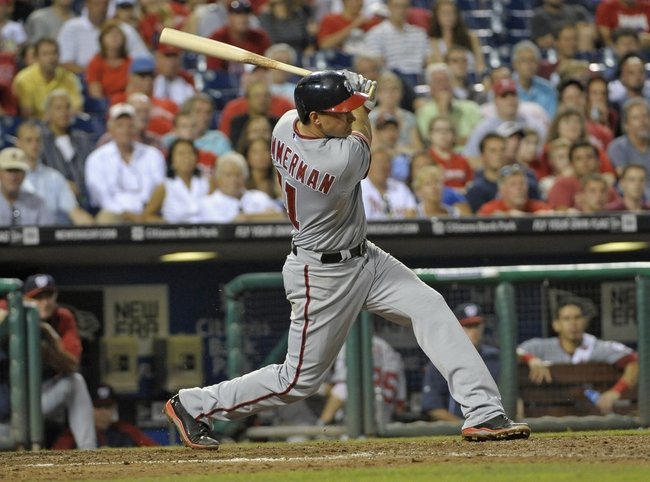 Jul 8, 2013; Philadelphia, PA, USA; Washington Nationals third baseman Ryan Zimmerman (11) hits a double in the ninth inning against the Philadelphia Phillies at Citizens Bank Park. The Phillies defeated the Nationals, 3-2. Mandatory Credit: Eric Hartline-USA TODAY Sports