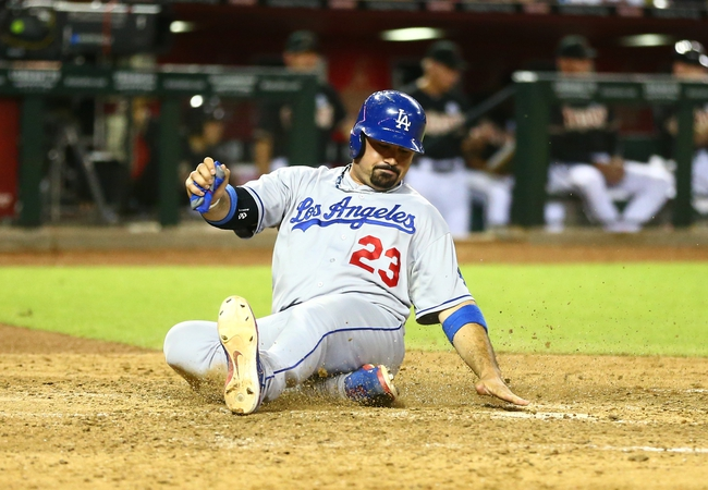 Jul. 8, 2013; Phoenix, AZ, USA: Los Angeles Dodgers first baseman Adrian Gonzalez scores in the seventh inning against the Arizona Diamondbacks at Chase Field. The Dodgers defeated the Diamondbacks 6-1. Mandatory Credit: Mark J. Rebilas-USA TODAY Sports