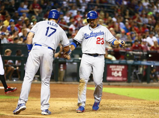 Jul. 8, 2013; Phoenix, AZ, USA: Los Angeles Dodgers first baseman Adrian Gonzalez (23) is congratulated by catcher A.J. Ellis after scoring in the seventh inning against the Arizona Diamondbacks at Chase Field. The Dodgers defeated the Diamondbacks 6-1. Mandatory Credit: Mark J. Rebilas-USA TODAY Sports