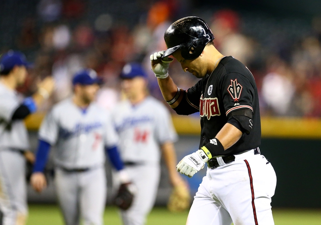 Jul. 8, 2013; Phoenix, AZ, USA: Arizona Diamondbacks third baseman Martin Prado facts after being the final out of the game against the Los Angeles Dodgers at Chase Field. The Dodgers defeated the Diamondbacks 6-1. Mandatory Credit: Mark J. Rebilas-USA TODAY Sports