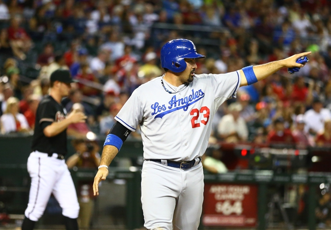 Jul. 8, 2013; Phoenix, AZ, USA: Los Angeles Dodgers first baseman Adrian Gonzalez celebrates after scoring in the seventh inning against the Arizona Diamondbacks at Chase Field. The Dodgers defeated the Diamondbacks 6-1. Mandatory Credit: Mark J. Rebilas-USA TODAY Sports