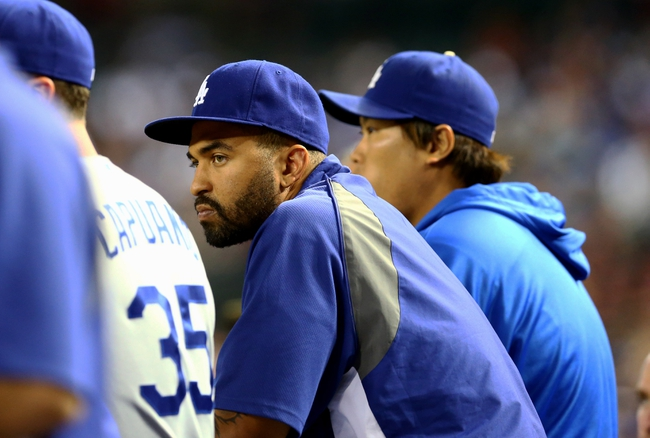 Jul. 8, 2013; Phoenix, AZ, USA: Los Angeles Dodgers injured outfielder Matt Kemp on the bench against the Arizona Diamondbacks at Chase Field. The Dodgers defeated the Diamondbacks 6-1. Mandatory Credit: Mark J. Rebilas-USA TODAY Sports