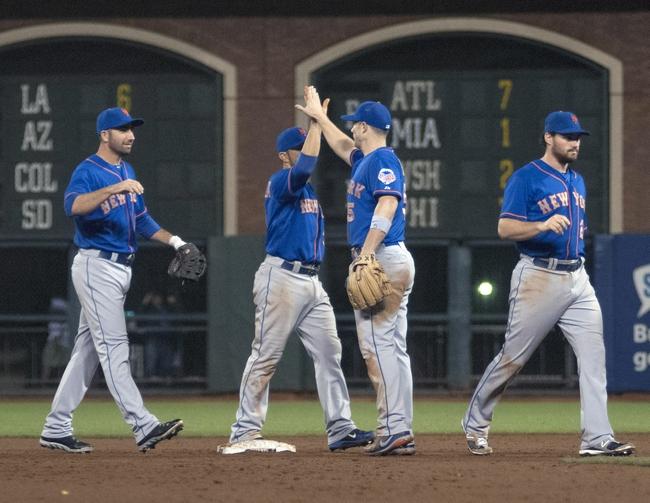 Jul 8, 2013; San Francisco, CA, USA; New York Mets third baseman David Wright (5) celebrates with team mates after defeating the San Francisco Giants in seventeen innings at AT&T Park. Mandatory Credit: Ed Szczepanski-USA TODAY Sports