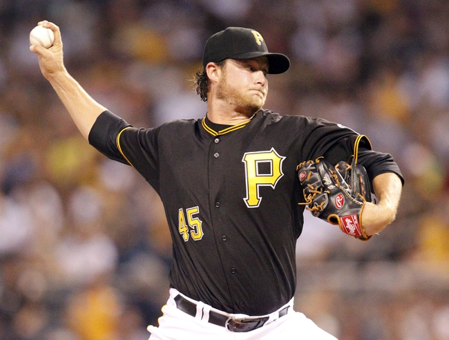 Jul 9, 2013; Pittsburgh, PA, USA; Pittsburgh Pirates starting pitcher Gerrit Cole (45) delivers a pitch against the Oakland Athletics during the first inning at PNC Park. Mandatory Credit: Charles LeClaire-USA TODAY Sports