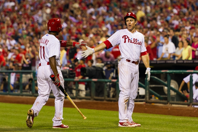 Jul 9, 2013; Philadelphia, PA, USA; Philadelphia Phillies shortstop Jimmy Rollins (11) and second baseman Chase Utley (26) celebrates scoring during the sixth inning against the Washington Nationals at Citizens Bank Park. The Phillies defeated the Nationals 4-2. Mandatory Credit: Howard Smith-USA TODAY Sports