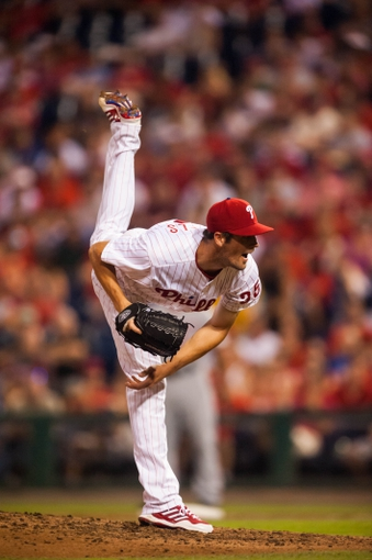 Jul 9, 2013; Philadelphia, PA, USA; Philadelphia Phillies pitcher Cole Hamels (35) delivers to the plate during the seventh inning against the Washington Nationals at Citizens Bank Park. The Phillies defeated the Nationals 4-2. Mandatory Credit: Howard Smith-USA TODAY Sports