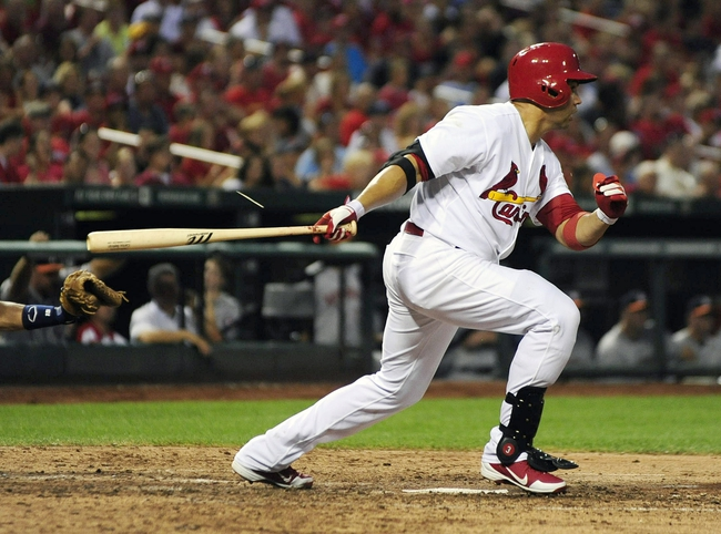 Jul 9, 2013; St. Louis, MO, USA; St. Louis Cardinals right fielder Carlos Beltran (3) hits a one run single off of Houston Astros starting pitcher Bud Norris (not pictured) during the fourth inning at Busch Stadium. Mandatory Credit: Jeff Curry-USA TODAY Sports