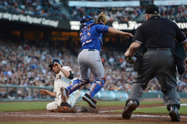 July 9, 2013; San Francisco, CA, USA; San Francisco Giants first baseman Brandon Belt (9, left) scores against New York Mets catcher Anthony Recker (20, right) on a fielder's choice hit by Giants catcher Guillermo Quiroz (12, not pictured) during the second inning at AT&T Park. Mandatory Credit: Kyle Terada-USA TODAY Sports