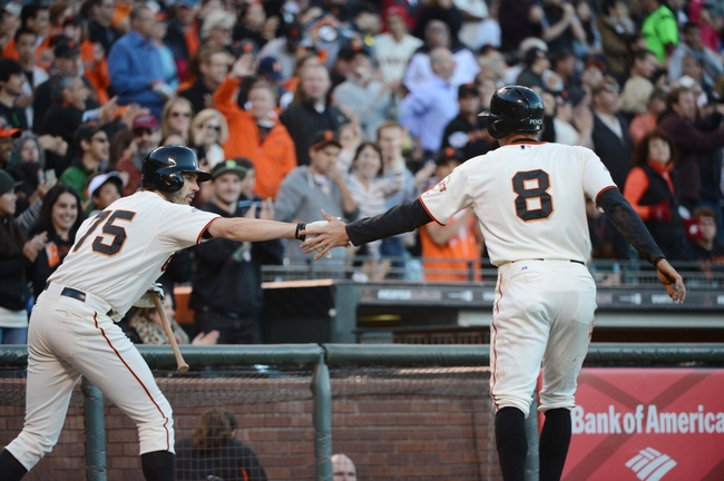 July 9, 2013; San Francisco, CA, USA; San Francisco Giants right fielder Hunter Pence (8) is congratulated by starting pitcher Barry Zito (75, left) for scoring during the second inning against the New York Mets at AT&T Park. Mandatory Credit: Kyle Terada-USA TODAY Sports