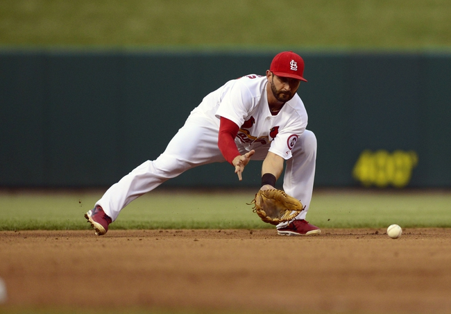 Jul 9, 2013; St. Louis, MO, USA; St. Louis Cardinals shortstop Daniel Descalso (33) fields a ball hit by Houston Astros second baseman Jose Altuve (not pictured) during the third inning at Busch Stadium. Mandatory Credit: Jeff Curry-USA TODAY Sports