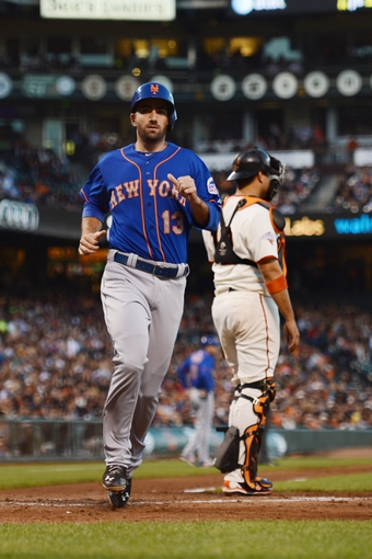 July 9, 2013; San Francisco, CA, USA; New York Mets first baseman Josh Satin (13) scores against San Francisco Giants catcher Guillermo Quiroz (12, right) during the fourth inning at AT&T Park. Mandatory Credit: Kyle Terada-USA TODAY Sports