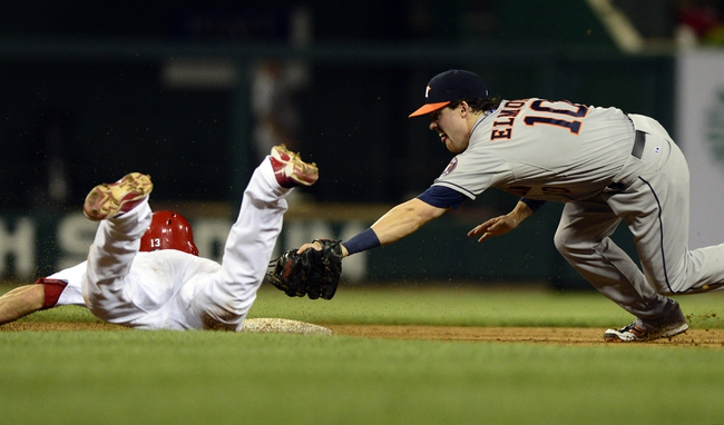 Jul 9, 2013; St. Louis, MO, USA; St. Louis Cardinals second baseman Matt Carpenter (13) slides safely past the glove of Houston Astros shortstop Jake Elmore (10) during the sixth inning at Busch Stadium. St. Louis defeated Houston 9-5. Mandatory Credit: Jeff Curry-USA TODAY Sports