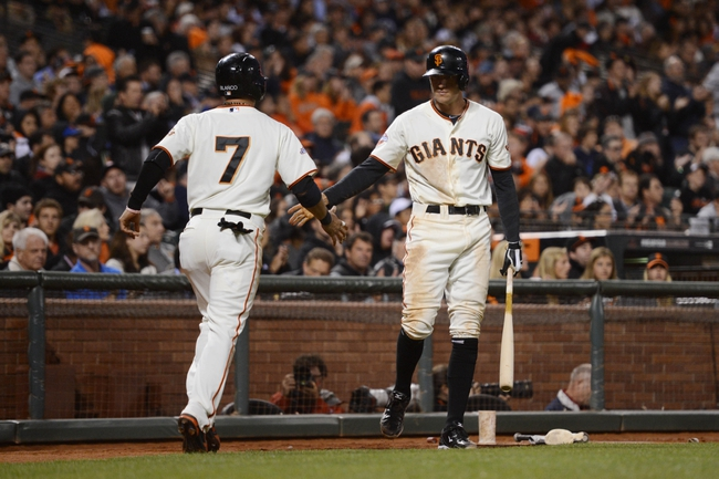 July 9, 2013; San Francisco, CA, USA; San Francisco Giants center fielder Gregor Blanco (7) is congratulated by right fielder Hunter Pence (8, right) for scoring during the fifth inning against the New York Mets at AT&T Park. Mandatory Credit: Kyle Terada-USA TODAY Sports