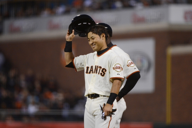 July 9, 2013; San Francisco, CA, USA; San Francisco Giants left fielder Kensuke Tanaka (37) acknowledges the crowd after recording his first MLB hit on a single during the fifth inning against the New York Mets at AT&T Park. Mandatory Credit: Kyle Terada-USA TODAY Sports