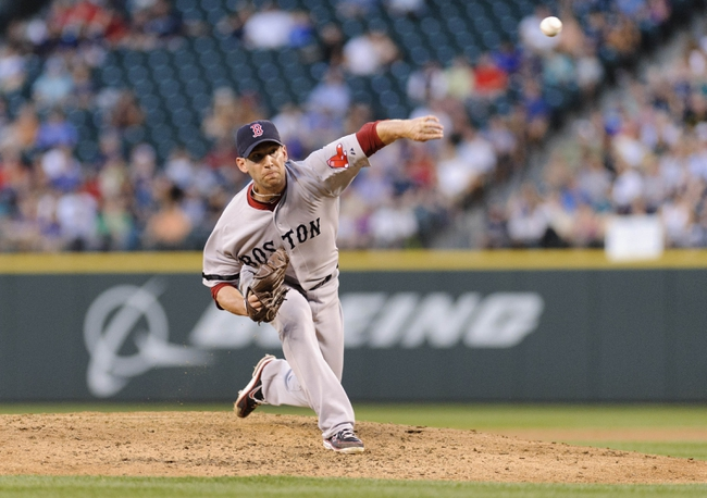 Jul 9, 2013; Seattle, WA, USA; Boston Red Sox relief pitcher Craig Breslow (32) pitches to the Seattle Mariners during the 4th inning at Safeco Field. Mandatory Credit: Steven Bisig-USA TODAY Sports