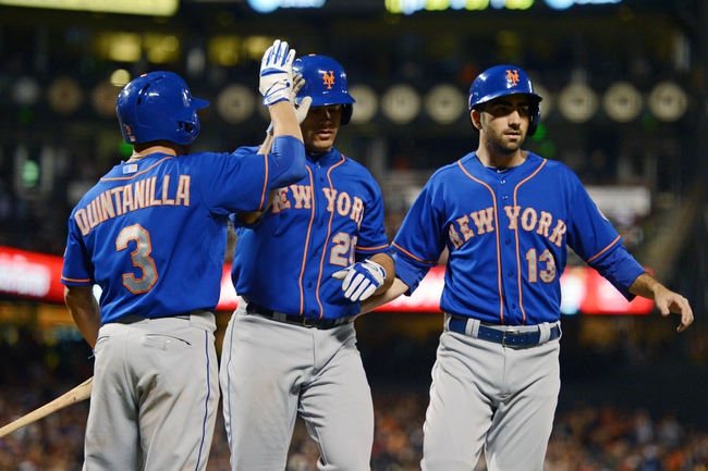 July 9, 2013; San Francisco, CA, USA; New York Mets catcher Anthony Recker (20, center) and first baseman Josh Satin (13) are congratulated by shortstop Omar Quintanilla (3) after Recker hit a two-run home run during the sixth inning against the San Francisco Giants at AT&T Park. Mandatory Credit: Kyle Terada-USA TODAY Sports