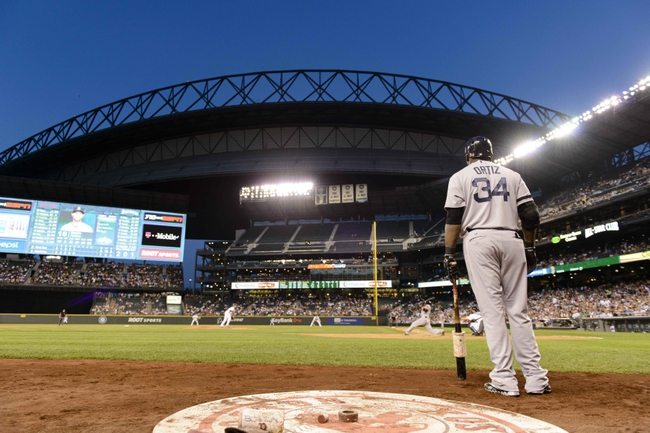 Jul 9, 2013; Seattle, WA, USA; Boston Red Sox designated hitter David Ortiz (34) waits on deck during the 6th inning against the Seattle Mariners at Safeco Field. Mandatory Credit: Steven Bisig-USA TODAY Sports
