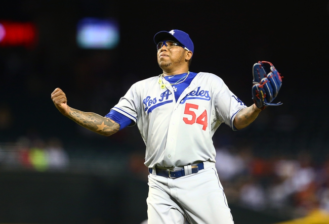 Jul. 9, 2013; Phoenix, AZ, USA: Los Angeles Dodgers pitcher Ronald Belisario reacts in the ninth inning against the Arizona Diamondbacks at Chase Field. Mandatory Credit: Mark J. Rebilas-USA TODAY Sports