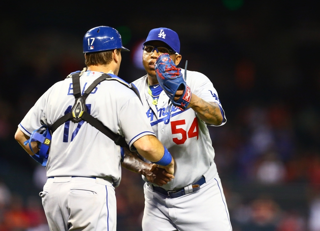 Jul. 9, 2013; Phoenix, AZ, USA: Los Angeles Dodgers pitcher Ronald Belisario (54) celebrates with catcher A.J. Ellis following the game against the Arizona Diamondbacks at Chase Field. Mandatory Credit: Mark J. Rebilas-USA TODAY Sports