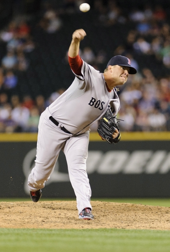 Jul 9, 2013; Seattle, WA, USA; Boston Red Sox relief pitcher Andrew Bailey (40) pitches to the Seattle Mariners during the 6th inning at Safeco Field. Mandatory Credit: Steven Bisig-USA TODAY Sports