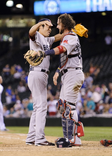 Jul 9, 2013; Seattle, WA, USA; Boston Red Sox relief pitcher Koji Uehara (19) and Boston Red Sox catcher Jarrod Saltalamacchia (39) hug after getting the final out against the Seattle Mariners at Safeco Field. Boston defeated Seattle 11-8. Mandatory Credit: Steven Bisig-USA TODAY Sports