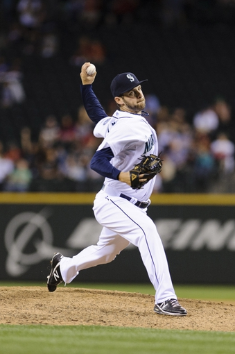 Jul 9, 2013; Seattle, WA, USA; Seattle Mariners relief pitcher Lucas Luetge (44) pitches to the Boston Red Sox during the 9th inning at Safeco Field. Boston defeated Seattle 11-8. Mandatory Credit: Steven Bisig-USA TODAY Sports