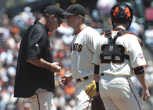 Jul 10, 2013; San Francisco, CA, USA; San Francisco Giants manager Bruce Bochy (15) takes the ball from starting pitcher Matt Cain (18) after removing him from the game during the first inning at AT&T Park. Mandatory Credit: Ed Szczepanski-USA TODAY Sports