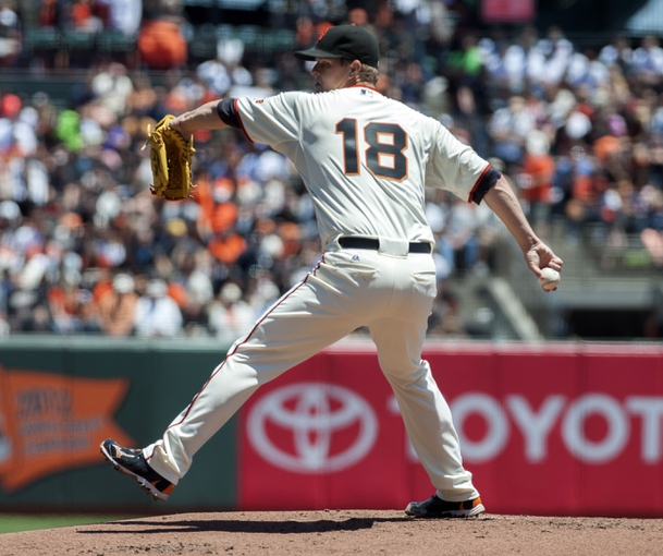 Jul 10, 2013; San Francisco, CA, USA; San Francisco Giants starting pitcher Matt Cain (18) pitches against the New York Mets during the first inning at AT&T Park. Mandatory Credit: Ed Szczepanski-USA TODAY Sports