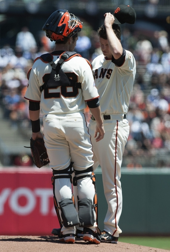 Jul 10, 2013; San Francisco, CA, USA; San Francisco Giants catcher Buster Posey (28) visits the mound to speak with starting pitcher Matt Cain (18) during the first inning at AT&T Park. Mandatory Credit: Ed Szczepanski-USA TODAY Sports