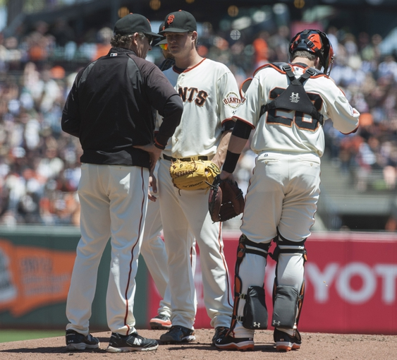 Jul 10, 2013; San Francisco, CA, USA; San Francisco Giants pitching coach Dave Righetti (33) visits the mound with starting pitcher Matt Cain (18) and catcher Buster Posey (28) during the first inning of the game against the New York Mets at AT&T Park. Mandatory Credit: Ed Szczepanski-USA TODAY Sports