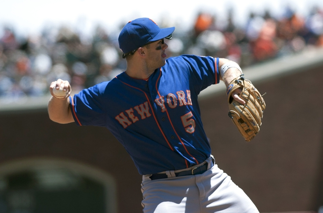Jul 10, 2013; San Francisco, CA, USA; New York Mets third baseman David Wright (5) throws the ball to first base during the fifth inning of the game against the San Francisco Giants at AT&T Park. Mandatory Credit: Ed Szczepanski-USA TODAY Sports