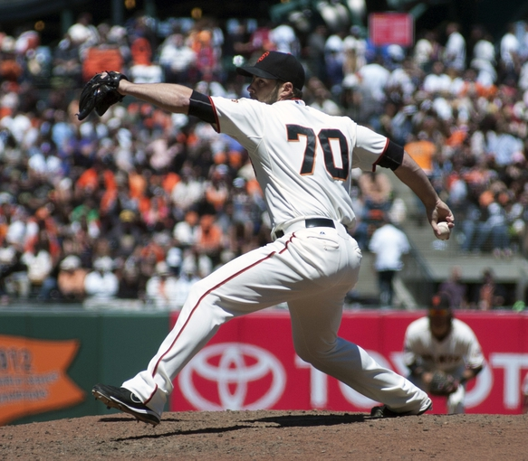Jul 10, 2013; San Francisco, CA, USA; San Francisco Giants relief pitcher George Kontos (70) pitches in relief against the New York Mets during the seventh inning at AT&T Park. Mandatory Credit: Ed Szczepanski-USA TODAY Sports
