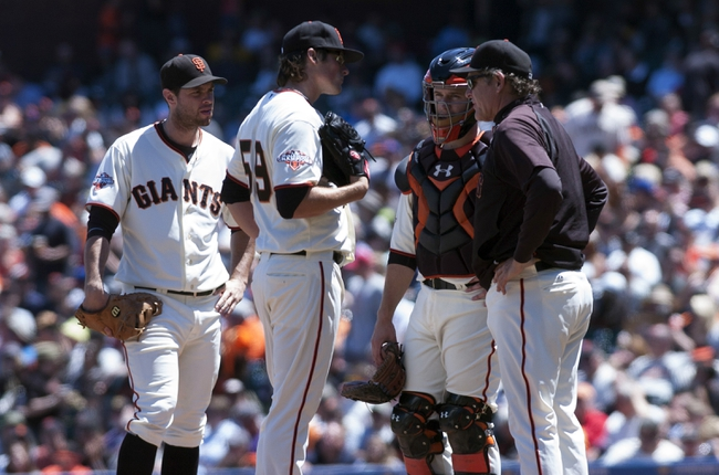 Jul 10, 2013; San Francisco, CA, USA; San Francisco Giants pitching coach Dave Righetti (33) visits the mound to speak with relief pitcher Michael Kickham (59) during the sixth inning of the game against the New York Mets at AT&T Park. Mandatory Credit: Ed Szczepanski-USA TODAY Sports