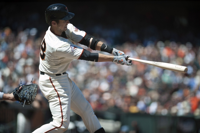 Jul 10, 2013; San Francisco, CA, USA; San Francisco Giants catcher Buster Posey (28) hits a single against the New York Mets during the ninth inning at AT&T Park. The New York Mets defeated the San Francisco Giants 7-2. Mandatory Credit: Ed Szczepanski-USA TODAY Sports