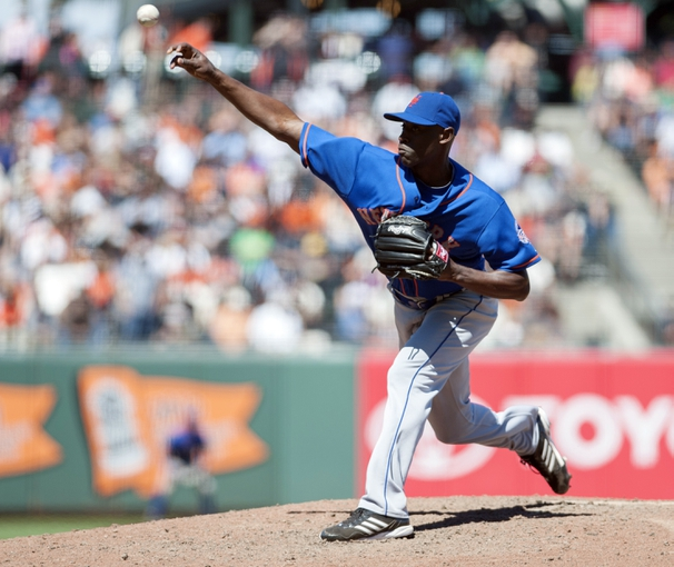 Jul 10, 2013; San Francisco, CA, USA; New York Mets relief pitcher LaTroy Hawkins (32) pitches in relief against the San Francisco Giants during the ninth inning at AT&T Park. The New York Mets defeated the San Francisco Giants 7-2. Mandatory Credit: Ed Szczepanski-USA TODAY Sports