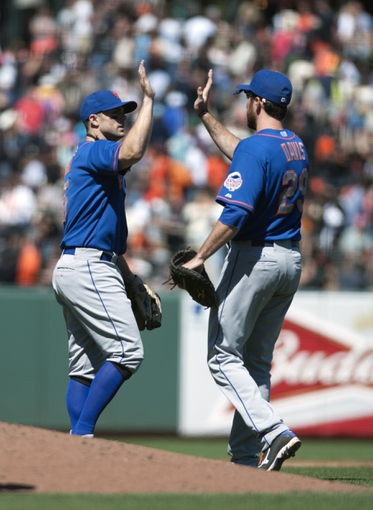 Jul 10, 2013; San Francisco, CA, USA; New York Mets third baseman David Wright (5) and first baseman Ike Davis (29) high five after defeating the San Francisco Giants 7-2. at AT&T Park. Mandatory Credit: Ed Szczepanski-USA TODAY Sports