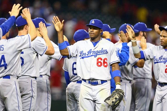 Jul. 9, 2013; Phoenix, AZ, USA: Los Angeles Dodgers outfielder Yasiel Puig (66) celebrates with teammates following the game against