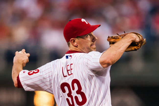 Jul 10, 2013; Philadelphia, PA, USA; Philadelphia Phillies pitcher Cliff Lee (33) delivers to the plate during the fifth inning against the Washington Nationals at Citizens Bank Park. Mandatory Credit: Howard Smith-USA TODAY Sports
