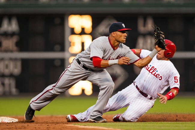 Jul 10, 2013; Philadelphia, PA, USA; Washington Nationals shortstop Ian Desmond (20) tries to turn a double play as Philadelphia Phillies catcher Carlos Ruiz (51) slides into second during the third inning at Citizens Bank Park. The Nationals defeated the Phillies 5-1. Mandatory Credit: Howard Smith-USA TODAY Sports