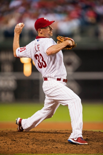 Jul 10, 2013; Philadelphia, PA, USA; Philadelphia Phillies pitcher Cliff Lee (33) delivers to the plate during the fifth inning against the Washington Nationals at Citizens Bank Park. The Nationals defeated the Phillies 5-1. Mandatory Credit: Howard Smith-USA TODAY Sports