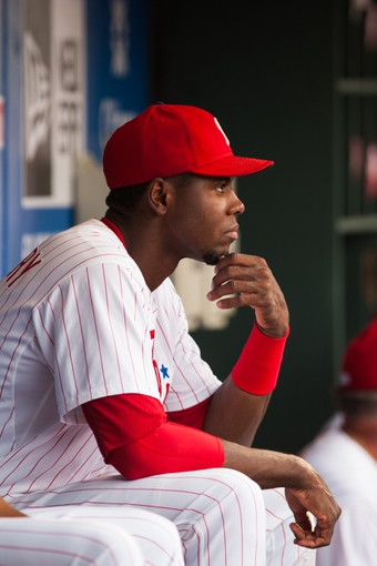 Jul 10, 2013; Philadelphia, PA, USA; Philadelphia Phillies center fielder John Mayberry (15) in the dugout prior to playing the Washington Nationals at Citizens Bank Park. The Nationals defeated the Phillies 5-1. Mandatory Credit: Howard Smith-USA TODAY Sports