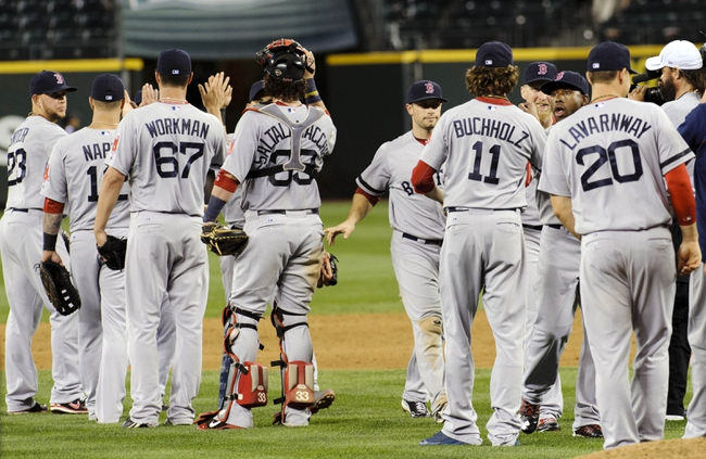 Jul 10, 2013; Seattle, WA, USA; The Boston Red Sox celebrate after defeating the Seattle Mariners at Safeco Field. Boston defeated Seattle 11-4. Mandatory Credit: Steven Bisig-USA TODAY Sports